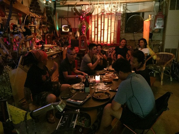 Multi-media artist Dex Fernandez at a dinner party in Williamsburg, Brooklyn, with Filipino friends, on 08/16/15.
